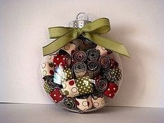 Cute & easy Christmas ornament Rolled up wrapping paper in clear ball!! Easy enough.