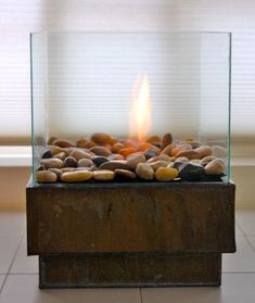 DIY firepit. Another pinner wrote: crafted this beauty from a planter, cheap frames, and a can of gel fuel. The simple modern shape and neutral rocks make this budget-friendly fire pit look totally luxe.