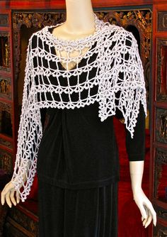 #Ravelry : Alezannah as Wrap or Ruana by vashtirama. Also has a cropped red beaded silk version $7.99