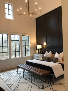 master bedroom paint colors modern bedroom decor with modern bed and tufted leather bench with boho rug in neutral bedroom with modern chandelier, Master Bedroom Accent Wall using paint color, Black Magic Modern Bedroom Decor, Master Bedroom Design, Home Bedroom, Bedroom Ideas, Bedroom Designs, Bedroom Furniture, Master Suite, Luxury Master Bedroom, Bedroom Dressers