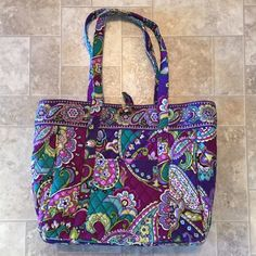 Vera Bradley Purple Tote Super cute Vera Bradley tote. Purple argil print. Has a computer holder in the center with heavy protective padding. Many pockets. Clip over the top. Used only once Vera Bradley Bags Totes