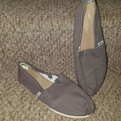 Toms Gray Flats Shoes NWOT Size w9 Toms Brand Authentic Shoes. New without Tags. Bought for my sister but they were the wrong size and she took tag off. TOMS Shoes Flats & Loafers