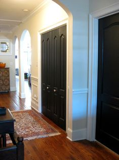 What do we think of interior doors painted black?  Would it help with little one's finger prints or show just as badly? Maybe Benjamin Moore's Black Satin or Deep Caviar- since mine are painted...