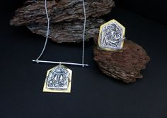 """Amuletic necklace and ring with ancient """"deity"""" die-stamp embossing in sterling silver with gold plated brass detailing."""