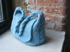 Ravelry: Twisted Cabled Companion Handbag pattern by Charlene Brown