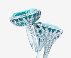The deep blue-green of tourmaline beckons the eye like a tropical sea in these diamond-encrusted rings