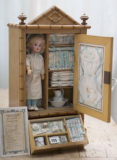 Antique French All Original Wooden Armoire with Doll and Fitted Lines Antique dolls at Respectfulbear.com