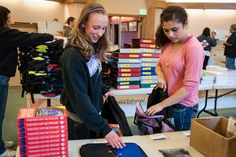 Volunteers from Northwood Middle School and Renton Christian Center work together to build backpacks for children in need within their community. (Photo: Laura Reinhardt/World Vision) #WorldVision