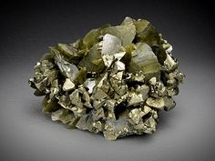 These are lustrous, well formed, brassy chalcopyrite crystals on lustrous brown siderite crystals. The locality for this piece is Kaiwu Mine, Hezhang County, Bijie Prefecture, Guizhou Province, China. The overall dimensions of this piece are 6cm wide by 4.6 cm tall and 2.4 cm front to back. There is contact damage around the edges of the piece and a few of the chalcopyrite.