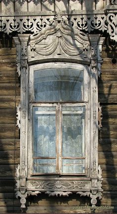 Old window in Tomsk, Siberia imagine beauty like this in country with harsh climate & conditions .