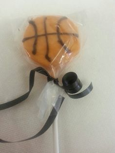 Chocolate dipped oreo pop. Basketball ball theme party