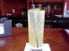 A classic summer time cocktail, the Tom Collins. Premium Gin, Sour mix topped with a splash of soda, garnished with a flag and served in a Collins glass. One word describes this libation, refreshing.