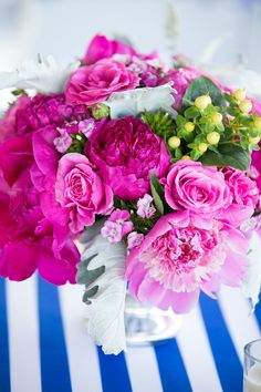 Amazing hot pink flower table centerpiece for this nautical blue and pink wedding reception!
