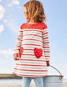 What's not to love about spots and stripes? Our jersey dress is great for playtime in the park and sweet enough for a Sunday roast. This easy-to-wear design has long sleeves to keep arms cosy and pretty heart-shaped pockets that are perfect for stashing treats.
