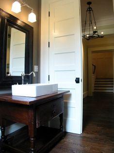 Dresser Homes - bathrooms - repurposed washstand, repurposed vanity, repurposed bathroom vanity, vessel sink, black mirror, pocket door, pow...