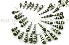 Green Zebra Jasper Faceted Drops (Quality AA+) Shape: Drops Faceted Length: 18 cm Weight Approx: 36 to 38 Grms. Size Approx: 8x20 to 9.5x30 mm Price $74.00 Each Strand