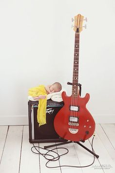 Newborn photography... This is perfect! Joe would love this idea!! :D We can use his guitar and amp