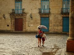 Cathedral Square in the rain at sunrise in Havana, Cuba.