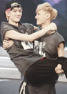 this is so cute, the way tao is looking at sehun, but its hilarious how big sehun is in taos arms:P:P