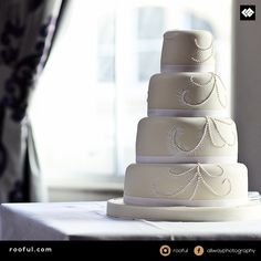 Stunning regal looking tiered cake - in keeping with the elegant room, minimal design, maximum impact (and taste!)