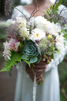 Woodland bouquet with succulents and blackberries - A winter woodland wedding photoshoot with lush florals, fur stoles and vintage details captured by Sarah Falugo - Styling: My Vintage Affair, Sarah Falugo and Lucy Jenner-Brown from Gwel an Mor