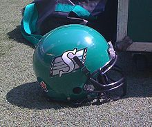 With the folding of both clubs in Moose Jaw and Saskatoon, the Regina Roughriders became a provincially community-owned club, and, consequently, changed their name to the Saskatchewan Roughriders in 1946.[20] Prior to the 1948 season, the Roughriders were in need of new uniforms as their red and black ones had become old and worn out. While visiting a surplus store in Chicago, executive member Jack Fyffe found a set of green and white uniforms and purchased them for the Roughriders, which…