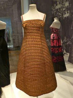 Way ahead of its time gold modern looking dress by Carosa 1958-9 at the V&A Museum's The Glamour of Italian Fashion