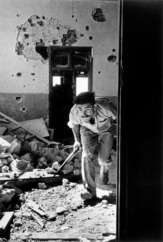 Robert Capa 1948 June 9th Jerusalem. A member of the Israeli government forces, the Haganah, in a building surrounding the old city, held by the Arabs