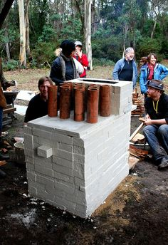 The Bauhaus Puja team kiln at Wood Fire Tasmania 2011 by vickigrima, via Flickr. The challenge then, was to build a kiln, mine and prepare a suitable clay body, artfully stack firing fuel, create a range of dinner ware, dry and fire it in readiness to serve up a meal to a panel of judges – in a single day from local resources. Josh Copus (NC!) crouching behind kiln.