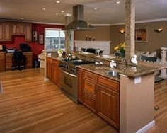 Kitchen island with stove and wrap around breakfast bar