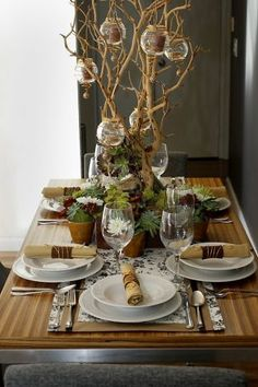 Food stylist Noel Advincula hit the dollar stores for his holiday table, which includes votives hung from a branch and a runner fashioned from printed shelf liner. Photo: Brant Ward, The Chronicle / SF