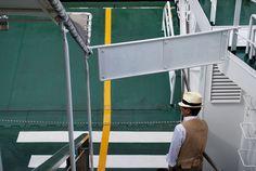 Natty gent in a panama hat riding the ferry to Miyajima, Japan