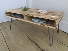 Boxer coffee table-mid century modern style featuring wormy maple and hairpin legs.