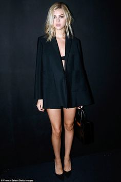 Fashion forward: Nicola Peltz wears just a bra and blazer to the Balenciaga show at Paris Fashion Week on Wednesday