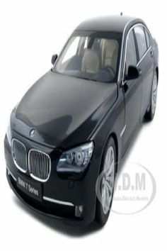 Brand new 1:18 scale diecast model of 2009 2010 2011 BMW 750Li F02 7 Series Citrine Black die cast model car by Kyosho. Has steerable wheels. Brand new box. Rubber tires. Opening hood, door and trunk. Made of diecast with some plastic parts. Detailed interior, exterior, engine compartment. Dimensions approximately L-10.5, W-4, H-3.5 inches. 2009 2010 2011 BMW 750Li F02 7 Series Diecast Car Model 1/18 Ruby Black Die Cast Car by Kyosho. Bmw Models, Rubber Tires, Diecast Model Cars, Performance Cars, Vehicles, Engine, Scale, Wheels, Exterior