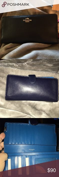 NWOT Coach Wallet 2 tone Coach Wallet Navy Blue and Turquoise, it's quite the wallet it has 15 slots for cards and ID 3 pockets for money and receipts with a zipper coin pocket, it has gold hardware Coach Bags Wallets