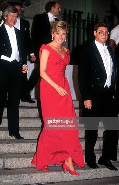 The Princess of Wales leaves a gala dinner in Washington DC, wearing a red Victor Edelstein dress, October 1990.