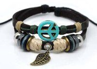 Bracelet - Brown Leather Peace Sign with Leaf kikisjewels. $15.95. Brown Turquoise Wooden and Silvertone Beads. Two  Strand  Brown Leather and  Beige Rope Cuff. Brown Leather  Cuff Bracelet Peace Sign and Leaf. Turquoise Peace Sign And Leaf  Charms. Save 41%!