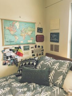 Travel-themed grey and white Baylor University dorm room.