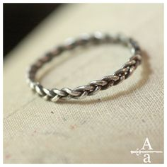 three strands are needed in a marriage: God, my husband, + me. I'm doing a braided wedding band.