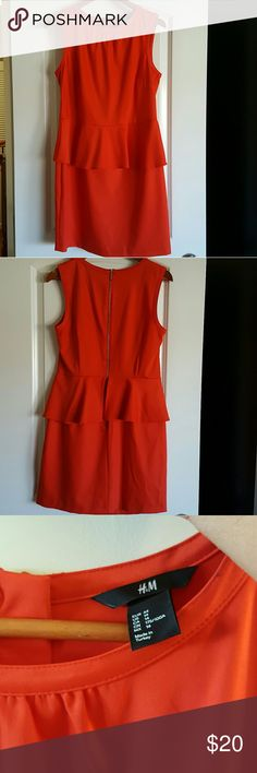 """H&M Red Dress NWOT This is a SUPER cute medium red (not so tomato red but more of a muted red with deep orange undertones). Size 14, but to me runs like a 12. Back zip, pemplum skirted mid section that covers any not flat tummy areas. This is unworn, mint condition. Length approx 35"""", upper waist were pemplum attaches is 17"""" across. Light sheen cotton dress. H&M Dresses"""