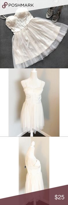 """Ivory Bustier Tulle Boho Ballerina Prom Dress XL Gorgeous Ivory Band of Gypsies Ballerina Bustier Dress. This dress is lovely. It comes in a size XL and is NWT. The straps are adjustable. The listing is for the dress only, but shoes are also available in my shop and necklace is coming soon. Bust: 36"""", Waist:33"""", Length:34"""". Please contact me with any questions. Band of Gypsies Dresses Mini"""