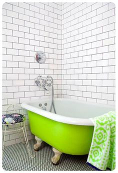 I LOVE THIS GREEN TUB! Ten interior design tips to get the perfect subway tile style from Moregeous