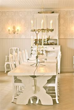 narrow table with lots of chairs