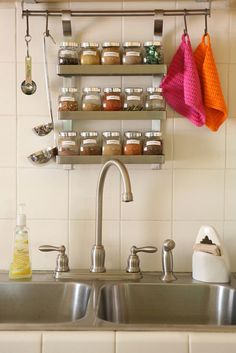 I love these little hanging racks.  It's difficult to let your stuff be out in the open, but still look organized.  Mounting it to the underside of a cabinet is a clever way to avoid too much destruction.  Also, where can I find that sponge holder!!