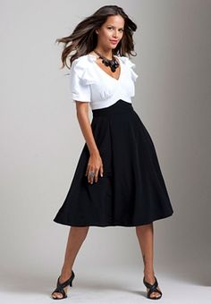 The shirt & skirt look of this dress is really nifty!  Very '40's and '50's vintage-inspired, to my eye, at least.  :)