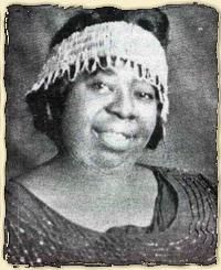 """1923- Ma Rainey makes her first recording.  Over the next five years, she will make over 100 records, earning her the title """"Mother of the Blues"""".  A number of these will have explicit lesbian content, & in 1925 Rainey will be arrested for throwing an orgy for her chorus girls.  She will be bailed out by fellow blues legend Bessie Smith.  As the Harlem scene dries up, Rainey will move to Georgia in 1935, where she will be active in the Baptist church."""