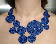 Dark blue circles crochet necklace .