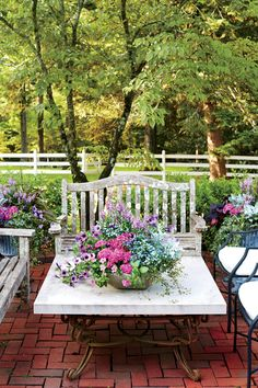 Romantic Tabletop Container | Enjoy nonstop color all season long with these container gardening ideas and plant suggestions. You'll find beautiful pots to adorn porches and patios. You may not have the space or patience to become a master gardener, but anyone can master container gardening. It's a cinch—all you need is a container (a planter in true gardener speak), potting soil, some plants and you're ready to go. Thinking of container gardening like this, it's easy to see why container
