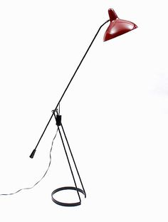 Botterweg Auctions Amsterdam > Black painted metal floor lamp with dark red shade, design F.H.Fiedeldij 1956, executed by Artimeta, Soest / the Netherlands